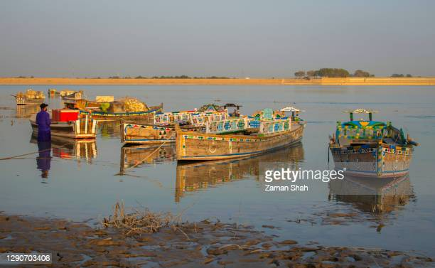 view of boats in the indus river - sind stock pictures, royalty-free photos & images