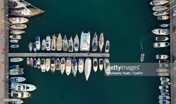 view of boats moored at harbor - latchi ストックフォトと画像