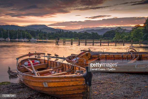 view of boats moored at lake - ambleside stock photos and pictures