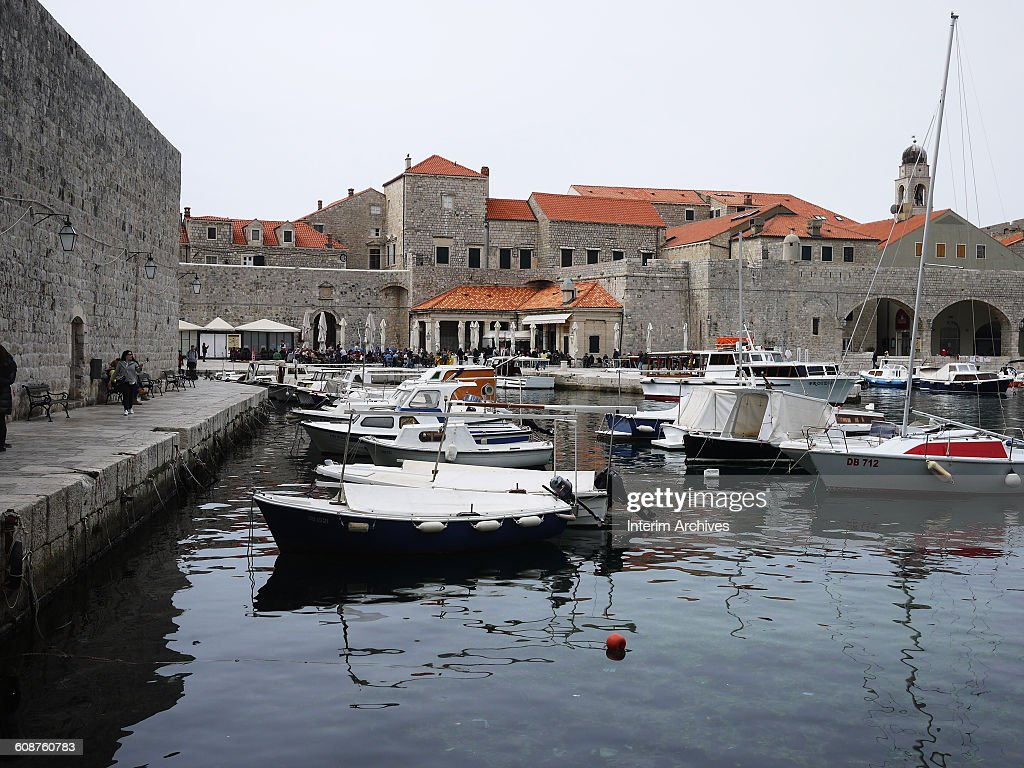 View of boats moored in the old harbor of Dubrovnik, Croatia, April 2015.
