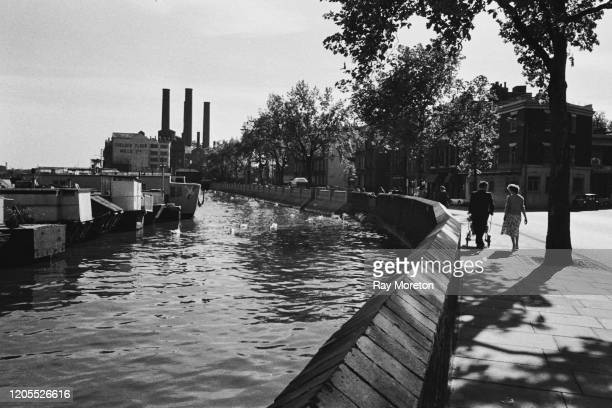 A view of boats moored on the Thames at Chelsea Embankment looking towards Chelsea Flour Mills to the west London September 1959