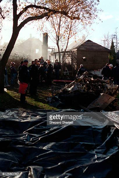 A view of body bags lined up at the site where American Airlines Flight 587 crashed into the neighborhood of the Rockaways Queens near JFK airport...
