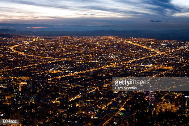 view of bogota city in the night - colombia stock pictures, royalty-free photos & images