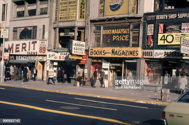 View of book stores employment agencies and beauty supply shops line 42nd Street in Manhattan's Times Square New York New York March 1 1970