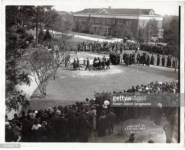 View of Booker T Washington's coffin being carried to the gravesite on the grounds of Tuskegee University November 1915