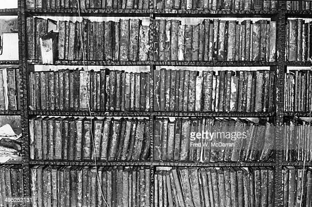 View of books still shelved in the aftermath of the 8th Street Books fire New York New York March 10 1976
