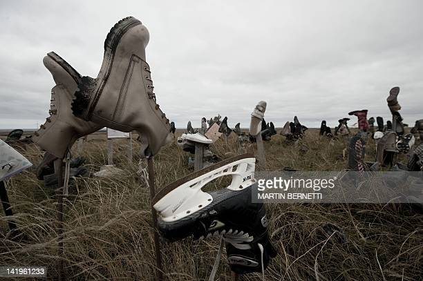 View of boots at the socalled Boot hill where tourists and locals leave a shoe before leaving the island according to tradition near Stanley in the...