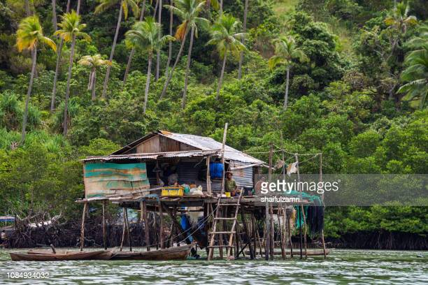 view of borneo sea gypsy house in bodgaya island, semporna sabah, malaysia. - shaifulzamri stock pictures, royalty-free photos & images