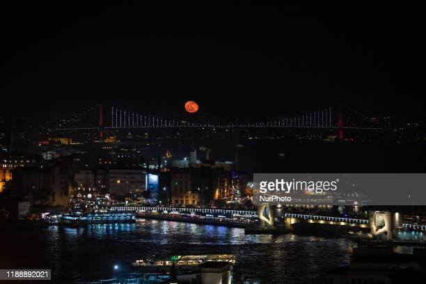 A view of Bosphorus with rising moon in the background over Istanbul Turkey on December 14 2019