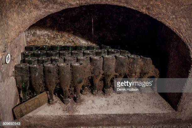 View of bottles in an alcove in the Dom Perignon cellars of the Moet Chandon winery Epernay France October 2009