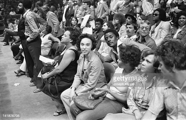 View of boxing fans in the stands at a Heavyweight Championship bout between American boxer Muhammad Ali and Uruguayan Alfredo Evangelista at the...