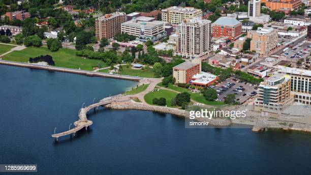 view of brant street pier with city - ontario canada stock pictures, royalty-free photos & images