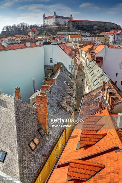 view of bratislava castle from the top of the st michael gate tower - bratislava stock pictures, royalty-free photos & images