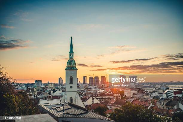 view of bratislava city with st. martin cathedral in front - slovakia stock pictures, royalty-free photos & images