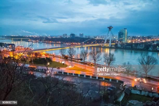View of Bratislava with the SNP Bridge at dusk
