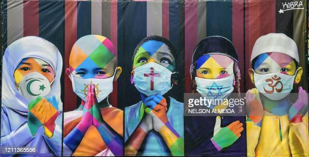 "View of Brazilian mural artist Eduardo Kobra's recent work ""Coexistence"" -which shows children wearing face masks due to the new coronavirus,..."