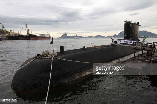 View of Brazilian submarine Timbira anchored during a presentation to the press in Rio de Janeiro Brazil on November 22 whilst other vessels and...