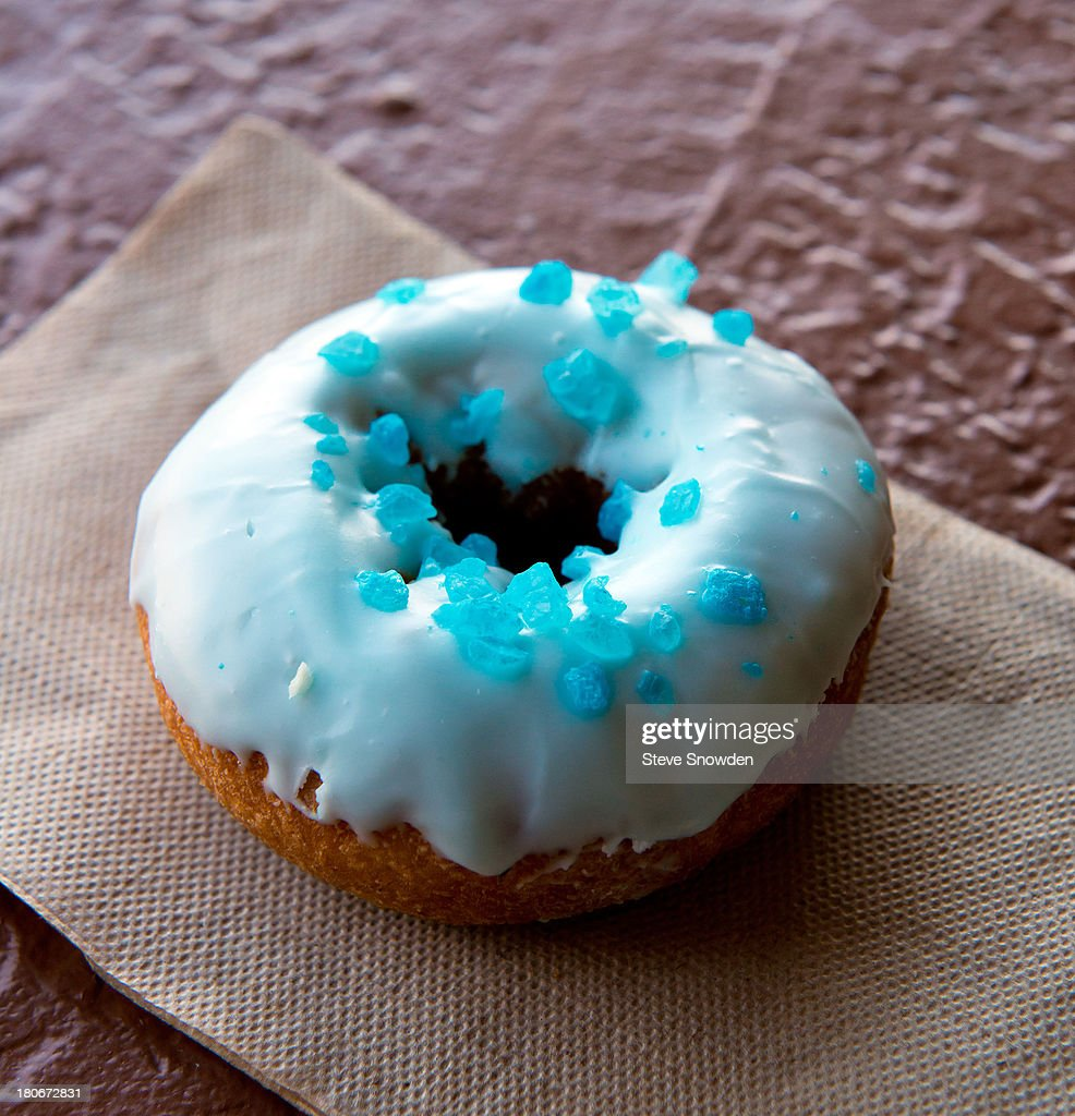 A view of 'Breaking Bad' inspired Blue Sky donuts in Rebel Donuts on August 31, 2013 in Albuquerque, New Mexico. Several years ago a production assistant for AMC's 'Breaking Bad' stopped by Rebel Donuts and asked them to make up several boxes of donuts topped with icing and blue rock candy to resemble Heisenberg's blue meth. The donuts were taken to the shooting location and were an instant hit. They are now a regular item in their shop.