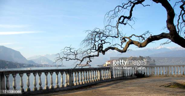 view of bridge against cloudy sky - stresa stock pictures, royalty-free photos & images