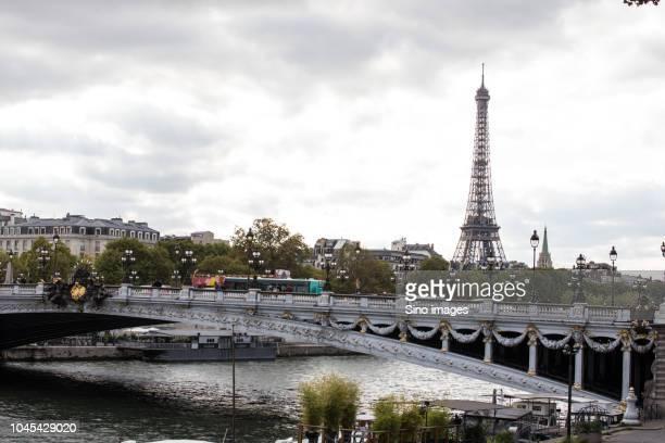 view of bridge against eiffel tower, paris, france - image photos et images de collection