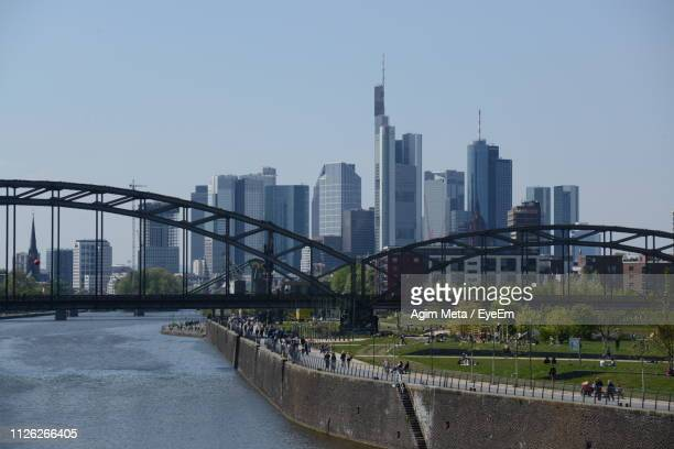 view of bridge and buildings against sky - agim meta stock-fotos und bilder