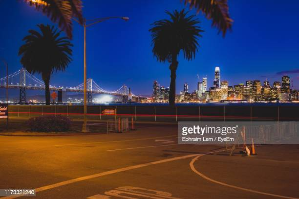 view of bridge and city buildings at night - ephraim lem stock pictures, royalty-free photos & images