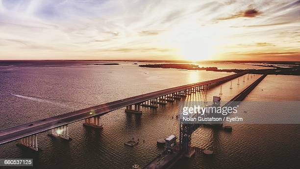 view of bridge over calm sea at sunset - galveston stock pictures, royalty-free photos & images