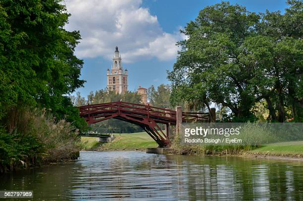 view of bridge over canal against cloudy sky - coral gables stock pictures, royalty-free photos & images