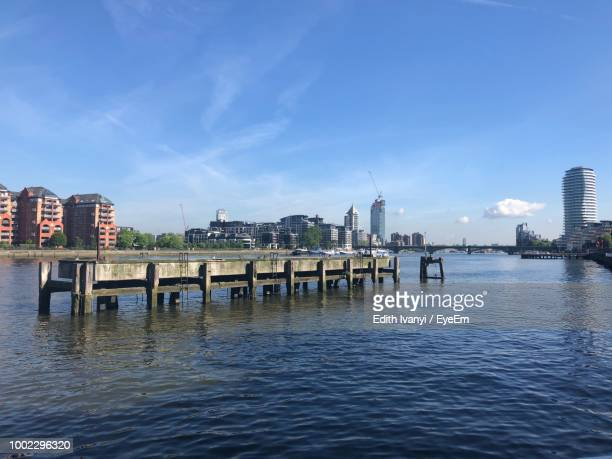 view of bridge over river against buildings - greater london stock pictures, royalty-free photos & images