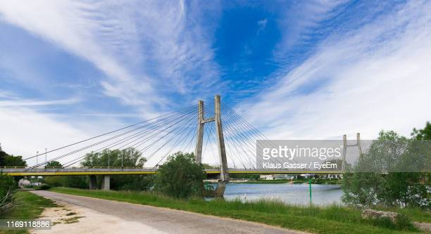 view of bridge over river against cloudy sky - シャロンシュルソーヌ ストックフォトと画像