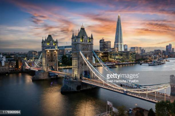 view of bridge over river against cloudy sky - london imagens e fotografias de stock