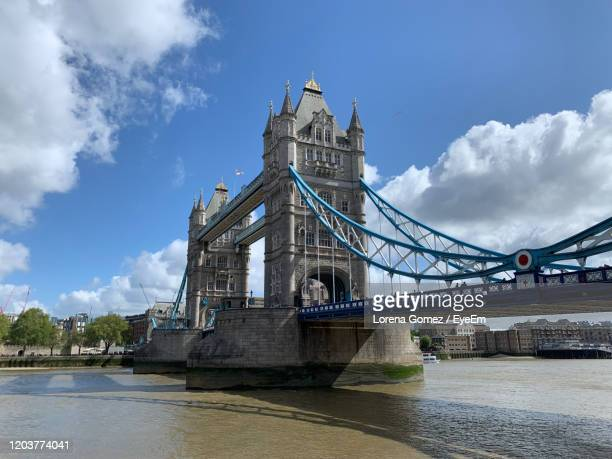 view of bridge over river against cloudy sky - lorena day stock pictures, royalty-free photos & images
