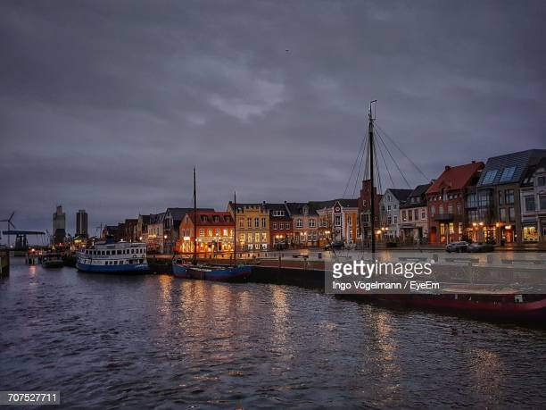 view of bridge over river against cloudy sky - husum stock-fotos und bilder