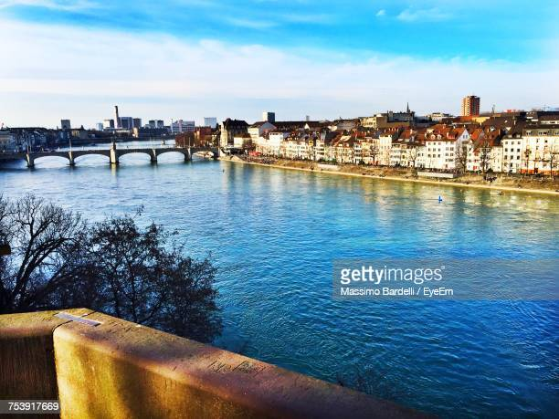 view of bridge over river against cloudy sky - basel switzerland stock photos and pictures