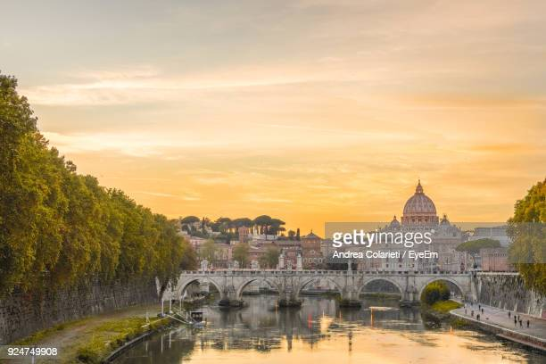 view of bridge over river against cloudy sky - rome italy stock pictures, royalty-free photos & images