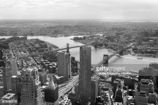 view of bridge over river along buildings - carolina fragapane stock pictures, royalty-free photos & images