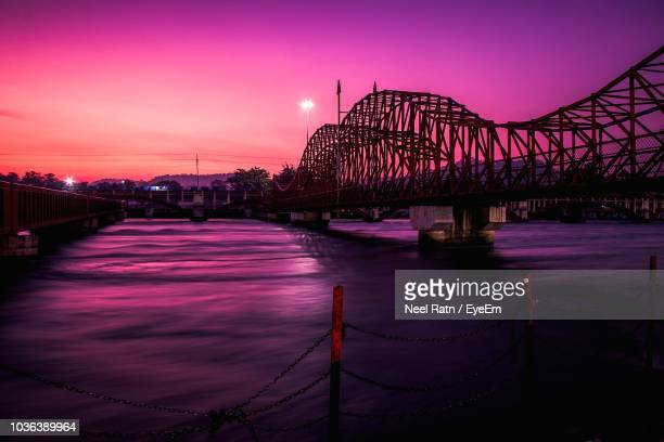 view of bridge over river at sunset - haridwar stock pictures, royalty-free photos & images
