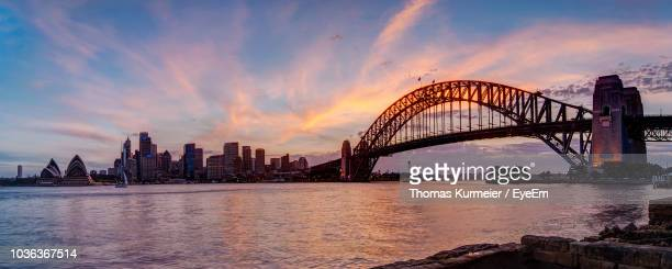 view of bridge over river in city - sydney harbor stock pictures, royalty-free photos & images