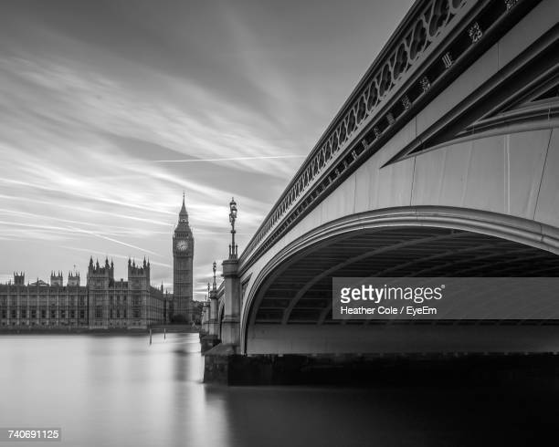 view of bridge over river in city - heather cole stock pictures, royalty-free photos & images