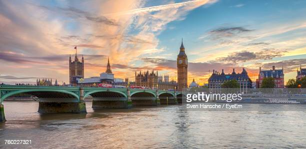 view of bridge over river in city - londra foto e immagini stock