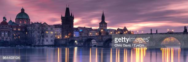 view of bridge over river in city - charles bridge stock pictures, royalty-free photos & images