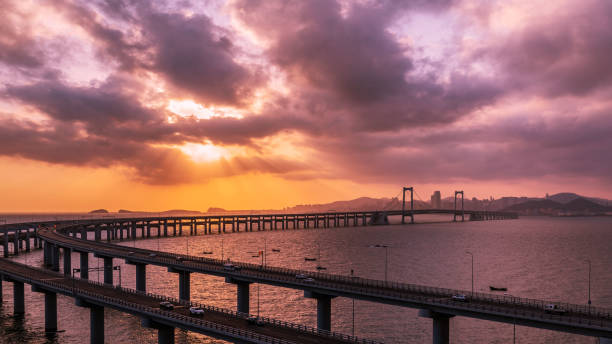 View Of Bridge Over Sea Against Cloudy Sky During Sunset, Dalian, China