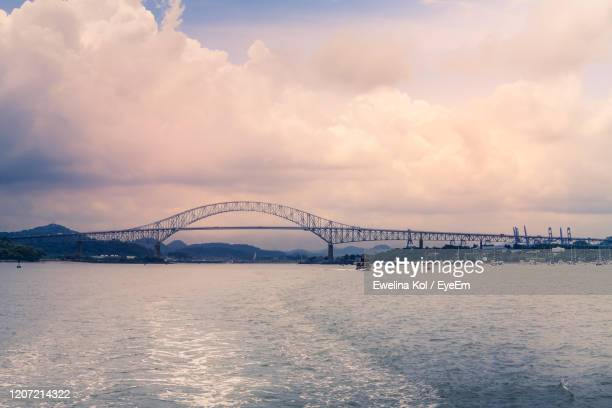 view of bridge over sea against cloudy sky - managua stock pictures, royalty-free photos & images