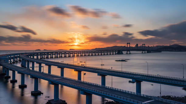 View Of Bridge Over Sea Against Sky During Sunset, Dalian, China