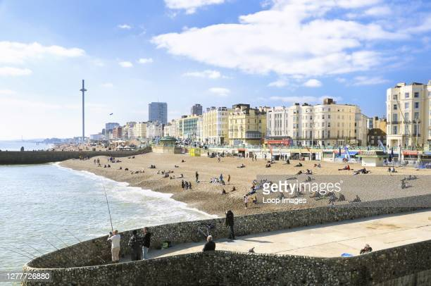 View of Brighton beach and the promenade from Palace Pier.