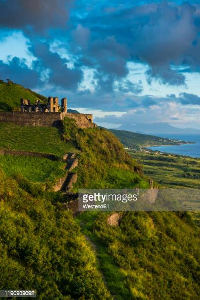 view of brimstone hill fortress against sky, st. kitts and nevis, caribbean - シント・ユースタティウス島 ストックフォトと画像