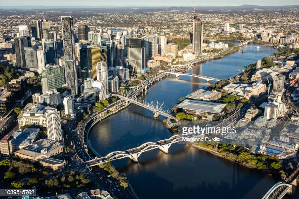 a view of brisbane city from a helicopter - queensland stock pictures, royalty-free photos & images