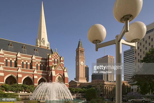 View of Brisbane City Hall in King George Square with the Albert Street Unit Church in the foreground