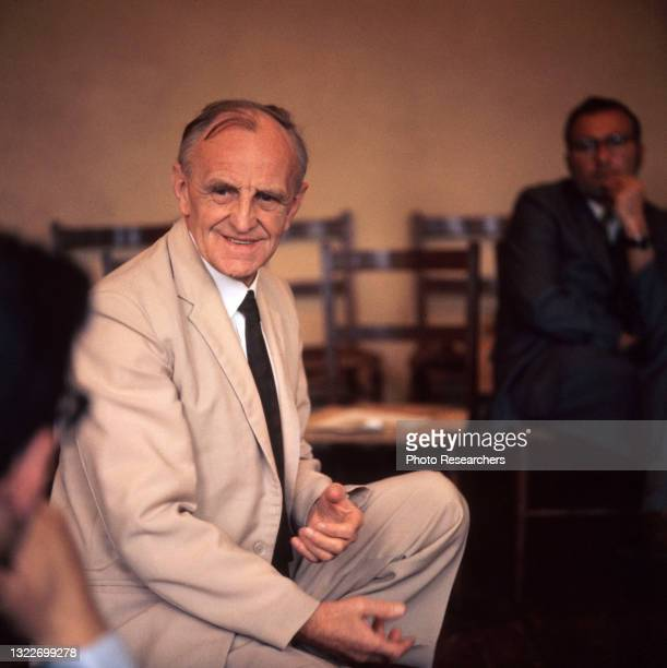 View of British developmental psychologist and pediatrician Dr Donald Winnicott as he attends an unspecified event, London, England, 1963.