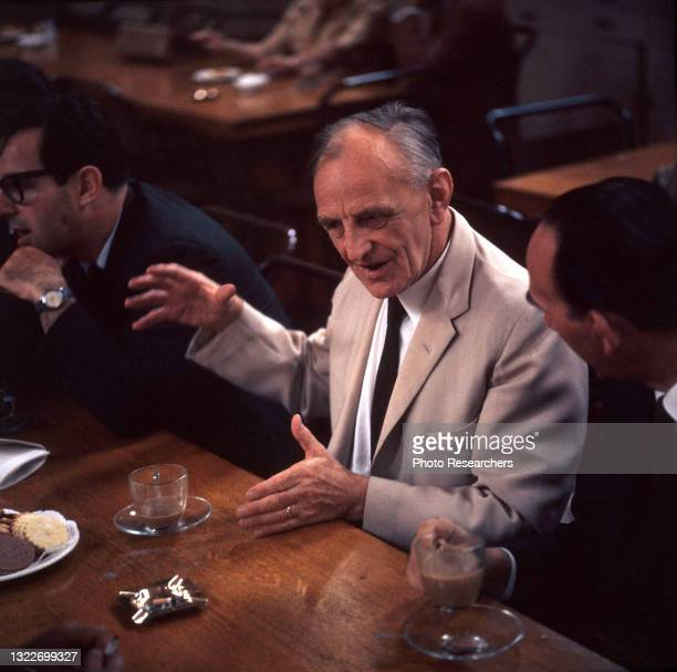 View of British developmental psychologist and pediatrician Dr Donald Winnicott as he talks with others at an unspecified event, London, England,...